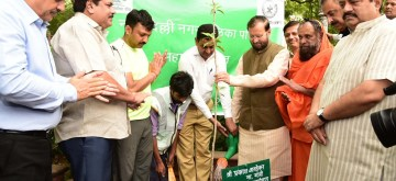 New Delhi: Union Minister for Environment, Forest and Climate Change and Information and Broadcasting Prakash Javadekar participates in tree plantation drive, jointly organised by Maharashtra Sadan and NDMC, at Maharashtra Sadan New Delhi on July 12, 2019. (Photo: IANS/PIB)