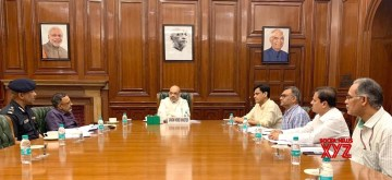 New Delhi: Union Home Minister Amit Shah chairs a high level meeting in New Delhi to review the current flood situation on July 13, 2019. Also seen Minister of State for Home Affairs Nityanand Rai, Home Secretary Rajiv Gauba and other officials. (Photo: IANS/PIB)