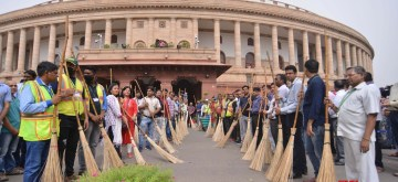 New Delhi: People participate in cleanliness drive during the Swachhata Abhiyan, at Parliament House in New Delhi, on July 14, 2019. (Photo: IANS)