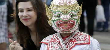 VANCOUVER, July 14, 2019 (Xinhua) -- A visitor poses for photos with a Thai dance performer during the 6th annual Thai Festival in Vancouver, Canada, July 13, 2019. This annual Thai cultural festival is expected to draw over 10,000 visitors. (Xinhua/Liang Sen/IANS)