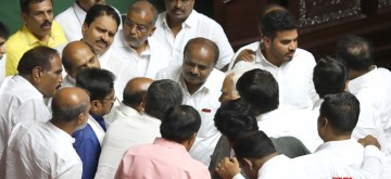 Bengaluru: Karnataka Chief Minister H.D. Kumaraswamy in a conversation with JD-S MLAs in Karnataka Legislative Assembly, in Bengaluru on July 19, 2019. Karnataka Assembly session resumed on July 19 in Bengaluru to continue the debate on the confidence motion Chief Minister H.D. Kumaraswamy moved on July 18 to prove that his Congress-JD-S coalition government has majority in the House. (Photo: IANS)