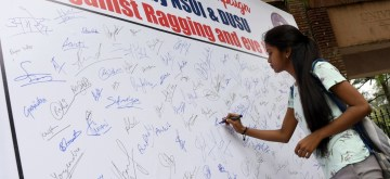 New Delhi: A student signs a board set up as part of a Signature Campaign initiated by NSUI and DUSU against ragging and eve-teasing, in New Delhi on July 25, 2019. (Photo: IANS)