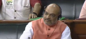New Delhi: Union Home Minister Amit Shah during a discussion on the Jammu and Kashmir Reorganisation Bill 2019 and the Jammu and Kashmir Reservation (Second Amendment) Bill 2019 in the Lok Sabha, on Aug 6, 2019. (Photo: IANS/LSTV)