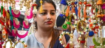 Kolkata: A woman busy buying rakhis ahead of Raksha Bandhan in Kolkata on Aug 11, 2019. (Photo: Kuntal Chakrabarty/IANS)