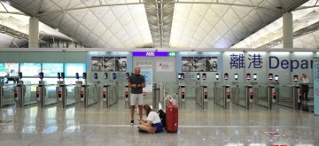 Hong Konng,Stranded passengers are seen at Hong Kong International Airport in Hong Kong, south China, Aug. 12, 2019. All flights in and out of China's Hong Kong Special Administrative Region were cancelled on Monday due to a protest held in the Hong Kong International Airport, according to local airport authority. (Xinhua/Lui Siu Wai/IANS)