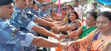 Prayagraj: Women tie 'Rakhis' on the wrists of Rapid Action Force (RAF) personnel during Raksha Bandhan celebrations, in Prayagraj on Aug 15, 2019. (Photo: IANS)