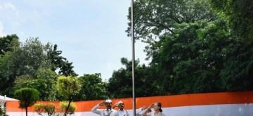 New Delhi: Congress President Sonia Gandhi unfurls the national flag at party headquarters in New Delhi on Aug 15, 2019. (Photo: Bidesh Manna/IANS)