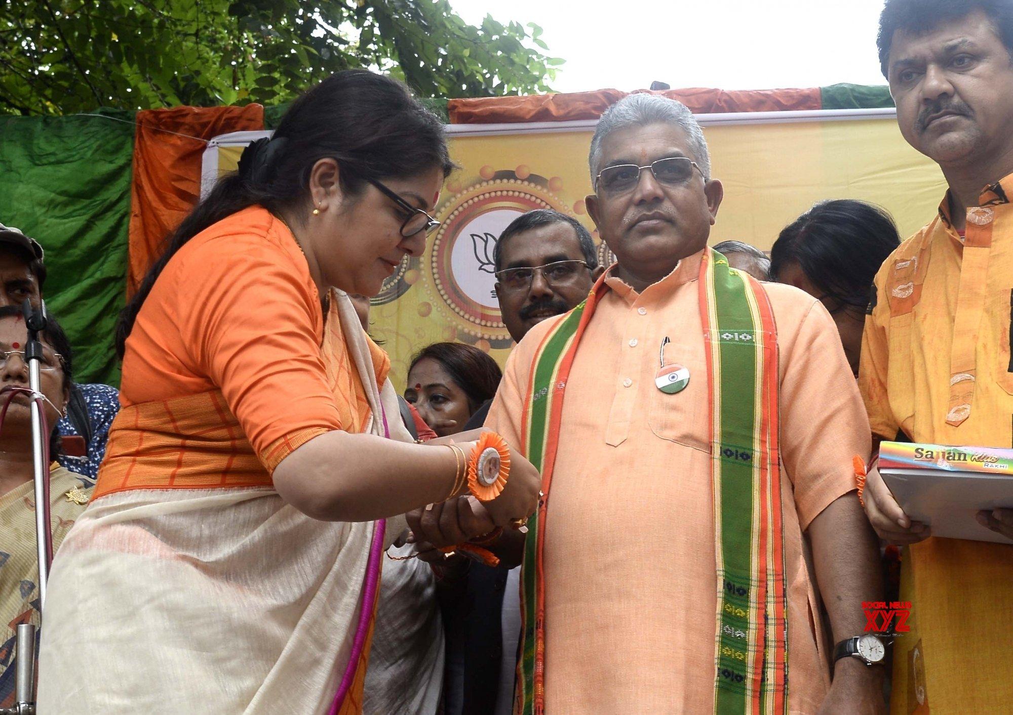 Kolkata: Raksha Bandhan - Locket Chatterjee ties Rakhi to Dilip Ghosh #Gallery