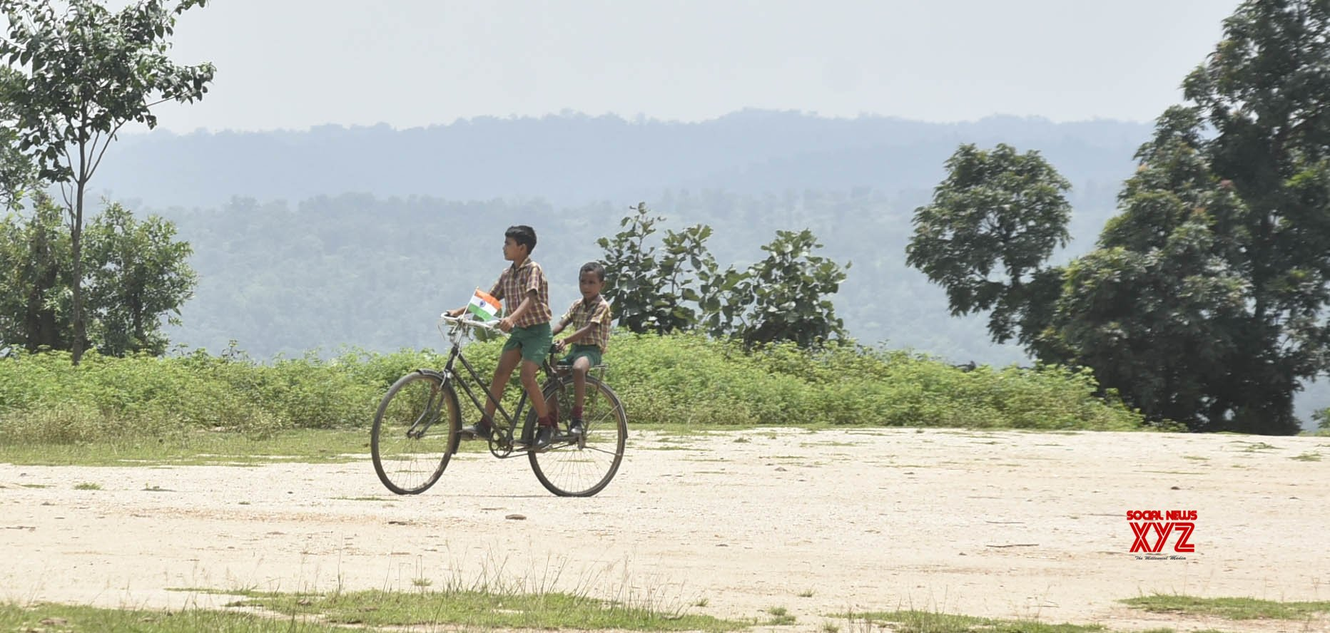 Ranchi: School children ride bicycle with tricolor #Gallery