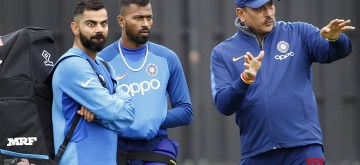 Southampton: India's captain Virat Kohli and coach Ravi Shastri with Hardik Pandya during a practice session ahead of a World Cup 2019 match against Afghanistan at the Hampshire Bowl in Southampton, England on June 19, 2019. (Photo: Surjeet Yadav/IANS)
