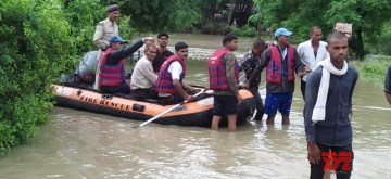 Shivpuri: NDRF personnel carry out rescue operations in Madhya Pradesh's flood affected Shivpuri, on Aug 16, 2019. (Photo: IANS)