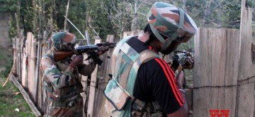 Shopian: A security personal takes position during an encounter with militants in Jammu and Kashmir's Shopian on July 31, 2019. (Photo: IANS)