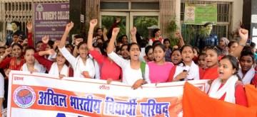 Patna: Activists of Akhil Bharatiya Vidyarthi Parishad (ABVP) stage a demonstration against a hike in admission fees, in Patna on Aug 29, 2019. (Photo: IANS)