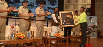 New Delhi: Union MoS Home Affairs G Kishan Reddy felicitates DIG Raghubir Lal in New Delhi on Sep 11, 2019. (Photo: IANS)
