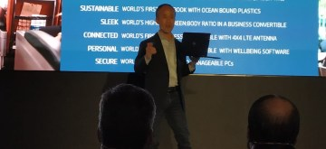 Tokyo: HP Inc  President (Personal Systems) Alex Cho unveils the Elite Dragonfly ultra-light premium convertible notebook in Tokyo on Sep 18, 2019. (Photo: IANS)