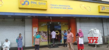 Mumbai: Depositors and investors gather outside Bhandup Branch of the Punjab & Maharashtra Cooperative (PMC) Bank after the Reserve Bank of India barred the bank from carrying out a majority of its routine business transactions for a six-month period, in Mumbai on Sep 24, 2019. (Photo: IANS)