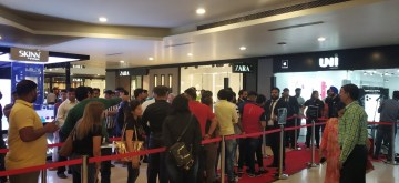 New Delhi: People queue up outside iWorld to purchase iPhones after the iPhone 11, iPhone 11 Pro, and iPhone 11 Pro Max smartphones went on sale across both online and offline retail stores in India; at Pacific Mall in New Delhi on Sep 27, 2019. (Photo: Bidesh Manna/IANS)