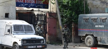 Sopore: Security personnel stand guard outside the police station where militants hurled a grenade, injuring two policemen, in Jammu and Kashmir's Sopore on June 7, 2019. (Photo: IANS)