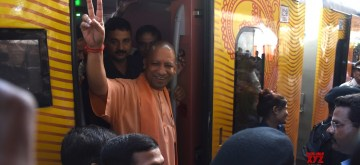 Lucknow: Uttar Pradesh Chief Minister Yogi Adityanath flashes victory sign during a programme organsied to flag off Lucknow-New Delhi Tejas Express in Lucknow on Oct 4, 2019. (Photo: IANS)