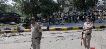 Amritsar: Security beefed up at Joda Phatak where family members of the victims of the Amritsar train tragedy where a local train crushed at least 60 people and left 72 injured while watching the burning of a Ravana effigy during Dussehra celebrations from a railway track; are protesting against the State Government, demanding justice for the victims and government jobs for the victims' kin, in Amritsar on Oct 8, 2019. (Photo: IANS)