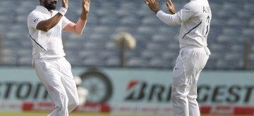 Pune: India's Mohammed Shami celebrates the wicket of Anrich Nortje with teammates on Day 3 of the second Test match between India and South Africa at Maharashtra Cricket Association Stadium in Pune, on Oct 12, 2019. (Photo: Surjeet Yadav /IANS)