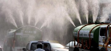 New Delhi: East Delhi Municipal Corporation (EDMC) tankers sprinkles water on a street as a measure to curb pollution in New Delhi on Oct 16, 2019. (Photo: IANS)