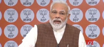 New Delhi: Prime Minister Narendra Modi addresses party workers from Varanasi, in New Delhi on Oct 24, 2019. (Photo: IANS)