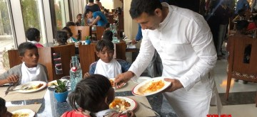 Madhya Pradesh Cabinet Minister Jitu Patwari serves food to children. The minister fed the poor children at a five-star hotel on the occasion of Diwali.