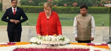 New Delhi: German Chancellor Dr. Angela Merkel lays wreath at the Samadhi of Mahatma Gandhi at Rajghat, in Delhi on Nov 1, 2019. (Photo: IANS/PIB)