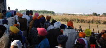 Kartarpur: Indian Sikh pilgrims reach Kartarpur in Narowal district of Punjab, Pakistan through the newly inaugurated Integrated Check Post of the Kartarpur Corridor, a religious link first in seven decades between India and Pakistan, to participate in the 550th birth anniversary celebrations of Guru Nanak Dev, on Nov 9, 2019. The first lot of 500 pilgrims from India reached Pakistan's Kartarpur to pay obeisance at the shrine of Guru Nanak Dev, the founder of Sikhism, after the opening of the historic corridor between the two countries on Saturday. (Photo: IANS)