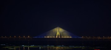 Mumbai: As part of the #SwedenIndiaSambandh campaign, the Consulate General of Sweden, Mumbai and the 'Rise Against Hunger India' (RAHI) have lit up the 5.6 km Rajiv Gandhi Bandra–Worli Sea Link from Dec 2-4 in blue and yellow, the colors of the Swedish flag in honour of the first visit of the Swedish Royal Couple to Mumbai. They will take part in a clean-up drive at the Versova Beach, Andheri West, and pay homage to the victims of the 26/11 Mumbai terror strikes, during their visit starting today. (Photo: IANS)