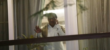 New Delhi: Former fiance Minister P. Chidambaram peeping through window at his residence after returning home from Tihar Jain on bail, in new Delhi on Dec 4, 2019. (Photo: IANS)