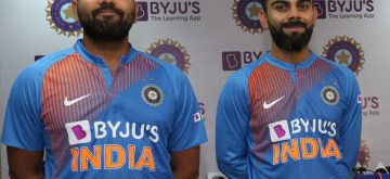 Dharamsala: Indian cricketers Rohit Sharma and Virat Kohli showcase the team's new jersey at a press conference on the eve of their first T20I match against South Africa, at Himachal Pradesh Cricket Association Stadium in Dharamsala on Sep 14, 2019. (Photo: Surjeet Yadav/IANS)