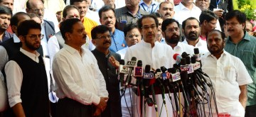 Nagpur: Maharashtra Chief Minister Uddhav Thackeray addresses a press conference on the second day of the Winter Session outside the state assembly in Nagpur on Dec 17, 2019. Also seen Shiv Sena leaders Sanjay Raut and Aaditya Thackeray. (Photo: IANS)