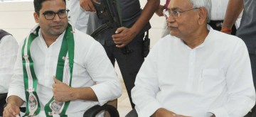 Patna: Bihar Chief Minister and JD-U chief Nitish Kumar with election strategist Prashant Kishor during a programme where the latter joined JD-U, in Patna on Sept 16, 2018. Kishor, 41-year-old former UN official, who founded the Indian Political Action Committee (I-Pac), was tasked with running the JD-U's campaign during the 2015 Bihar polls after he parted ways with the Bharatiya Janata Party (BJP). (Photo: IANS)