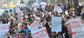 New Delhi: Students and teachers of Delhi University under the banner of Delhi University Teachers Association (DUTA), stage a demonstration demanding absorption and promotion of the ad-hoc teachers, in New Delhi on Jan 10, 2020. (Photo: IANS)