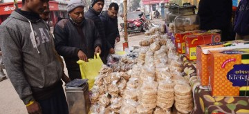 Patna: People busy buying 'Tilkut' - a sweet prepared from sesame seeds and jaggery - on the occasion of Makar Sankranti, in Patna on Jan 14, 2020. (Photo: IANS)