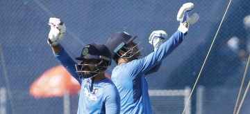 Pune: Indian cricketers MS Dhoni and Kedar Jadhav during a practice session in Pune on Oct 24, 2017. (Photo: Surjeet Yadav/IANS)