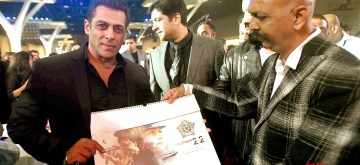 Mumbai: A copy of the Mumbai Police Calendar being presented to Bollywood superstar Salman Khan at the grand event Umang in Mumbai. (Photo: IANS)