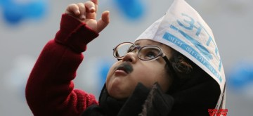 New Delhi: A young Aam Aadmi Party (AAP) supporter dressed up as Delhi Chief Minister Arvind Kejriwal outside a counting center during the counting of votes for the recently concluded Delhi Assembly elections 2020, in New Delhi on Feb 11, 2020. Early trends showed the AAP ahead of its rival BJP as counting of votes began in all the assembly constituencies in Delhi on Tuesday. (Photo: IANS)