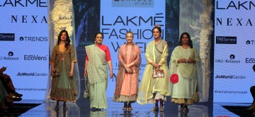 "Mumbai: Awaaz Foundation founder and anti-noise pollution activist Sumaira Abdulali held a ""decibel meter' and walked the ramp at the Lakme Fashion Week for Shades of India's 'Crafted in Crochet' by tribal women, in Mumbai on Feb 14, 2020. Also seen rally racer driver Garima Avtar, bartender Ami Shroff, environmentalist Sumaira Abdulali, costume designer Ekta Lakhani and columnist Aparna Piramal. (Photo: IANS)"