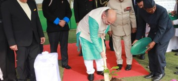 Itanagar: Union Home Minister Amit Shah plants a sapling at Raj Bhawan in Itanagar, Arunachal Pradesh on Feb 20, 2020. (Photo: IANS)