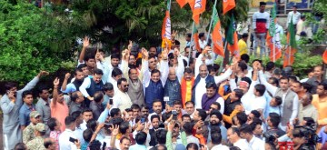 Bhopal: BJP Vice-President and former Madhya Pradesh Chief Minister Shivraj Singh Chouhan, party leader Kailash Vijayvargiya along with party workers celebrate as the BJP intensified the exercise to form the government soon after the Kamal Nath government collapsed in Madhya Pradesh followed by Nath's resignation, at the state party headquarters in Bhopal on March 20, 2020. (Photo: IANS)