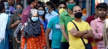 Kolkata: Patients wear masks as a precautionary measure against COVID-19 amid coronavirus pandemic, as they queue up outside the Beleghata ID hospital in Kolkata on March 20, 2020. (Photo: Kuntal Chakrabarty/IANS)