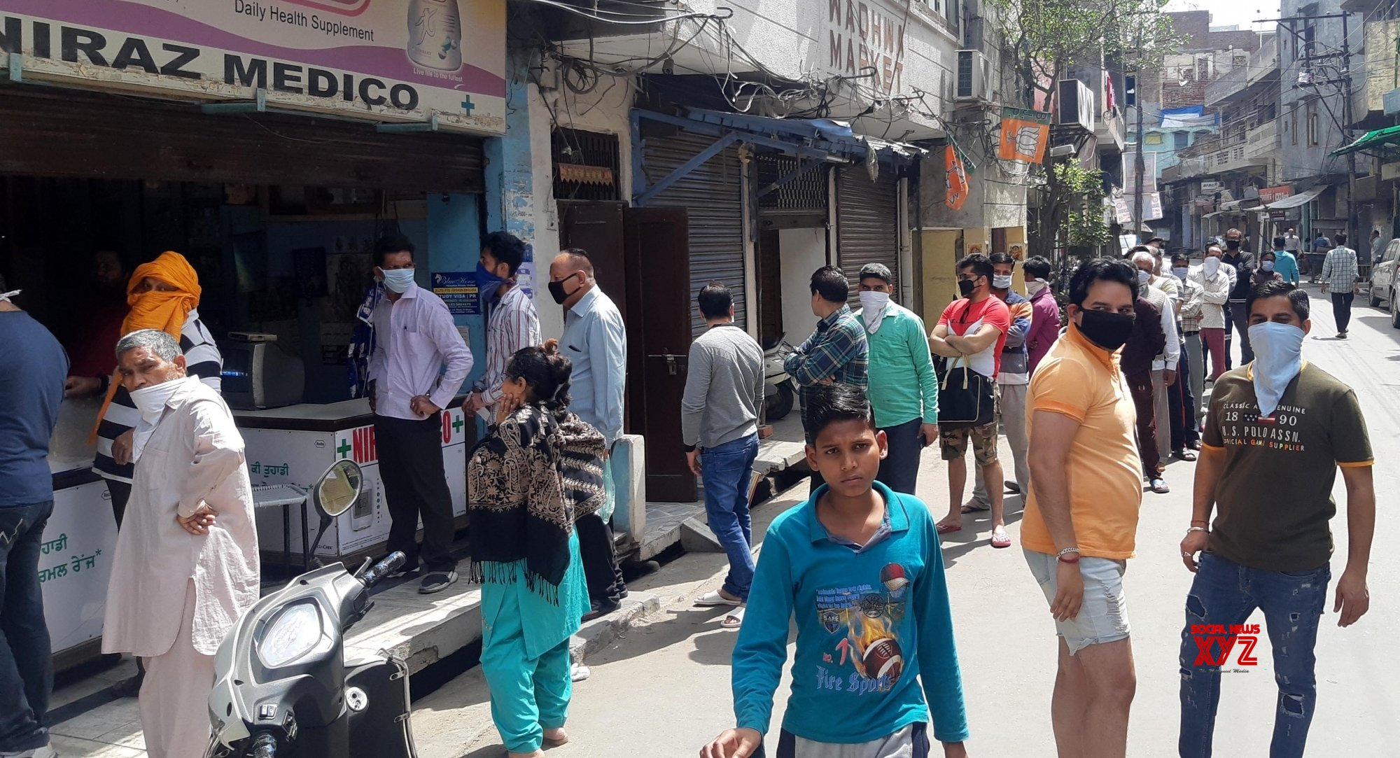 Amritsar: People practise social distancing while shopping for essentials on Day 2 of nationwide lockdown #Gallery