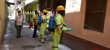 Patna: Patna Municipality workers spray disinfectents across different areas of the city on Day 2 of the 21-day nationwide lockdown imposed by the Narendra Modi government over the coronavirus pandemic; on March 26, 2020. (Photo: IANS)