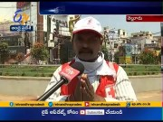 Red Cross volunteers distribute Masks to people in Nellore  (Video)