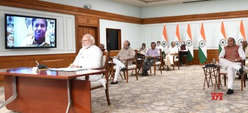 New Delhi: Prime Minister Narendra Modi holds a meeting with all the floor leaders of various parties in the Parliament on COVID-19 via video conferencing, in New Delhi on Apr 8, 2020. Also seen Union Home Minister Amit Shah, Defence Minister Rajnath Singh, Health Minister Harsh Vardhan, Social Justice and Empowerment Minister Thawar Chand Gehlot, MoS External Affairs V. Muraleedharan and Finance Minister Nirmala Sitharaman. (Photo: IANS/PIB)