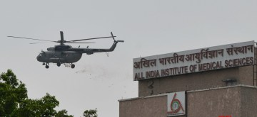 New Delhi: An IAF chopper showers flower petals on Delhi's All India Institute of Medical Sciences (AIIMS) to show honour and express their gratitude towards the coronavirus warriors who are battling the pandemic, during the extended nationwide lockdown imposed to mitigate the spread of coronavirus, on May 3, 2020. (Photo: IANS)