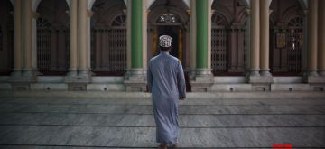 KATHMANDU, May 25, 2020 (Xinhua) -- A man heads towards a mosque before offering Eid al-Fitr prayers during the lockdown amid the COVID-19 outbreak, in Kathmandu, Nepal, on May 25, 2020. (Photo by Sulav Shrestha/Xinhua/IANS)